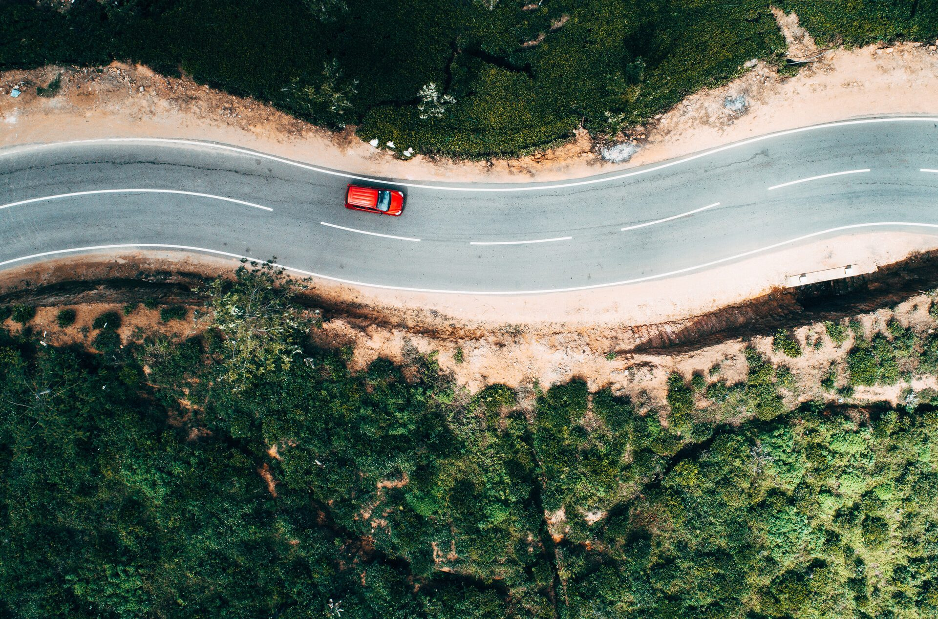 Aerial view of the car on a picturesque road.