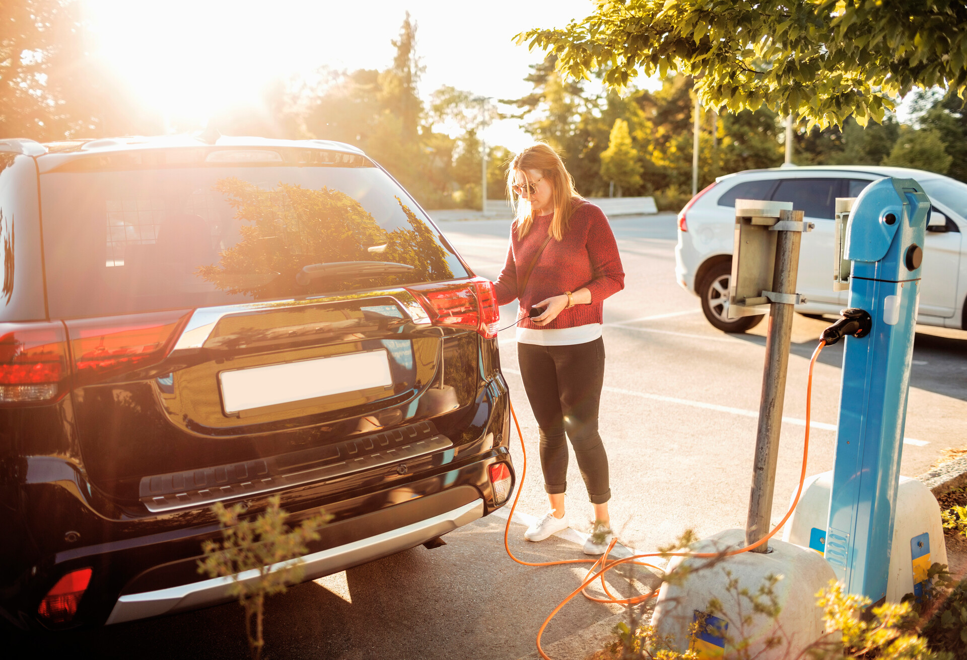 A girl charging an electric car