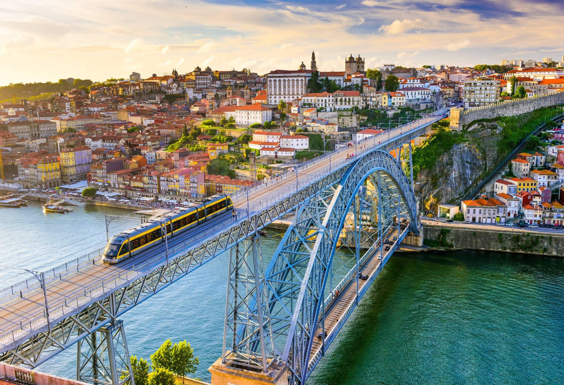 Portugal cityscape on the Douro River and Dom Luis I Bridge.