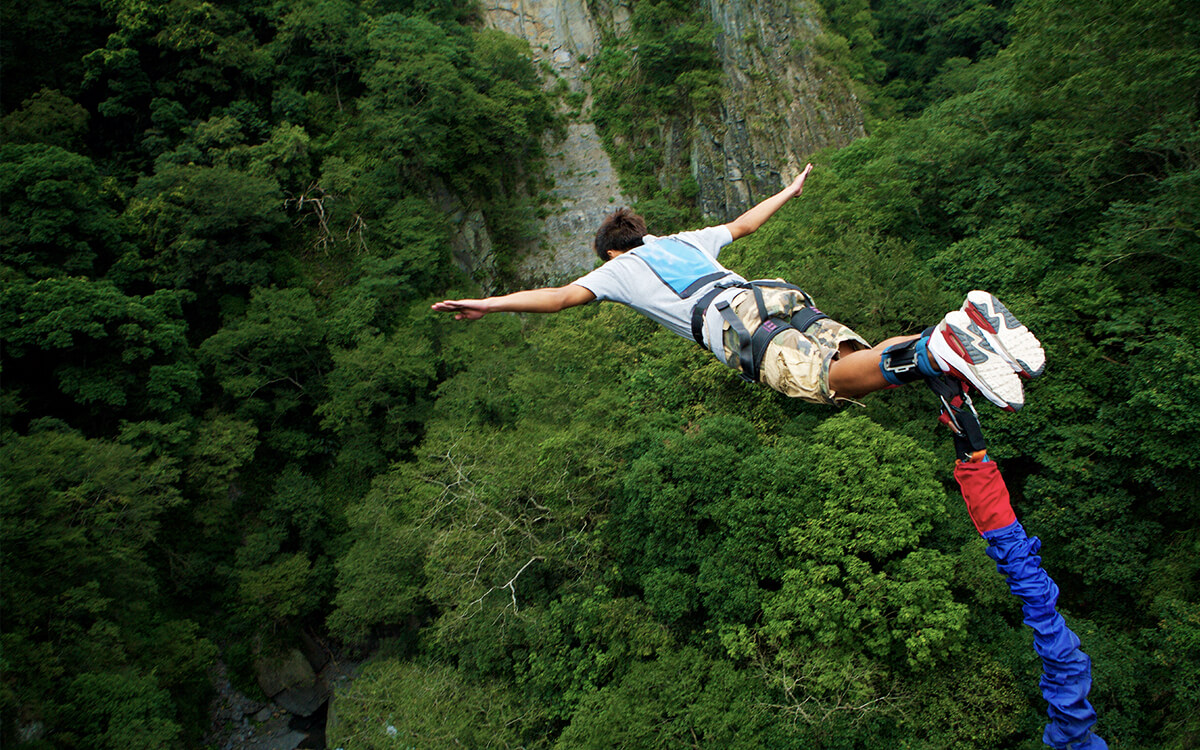 Get your heart racing with a long fall while bungee jumping in Switzerland.