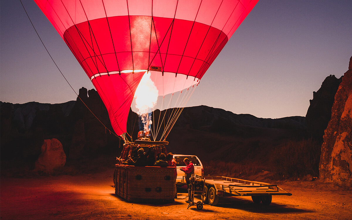 Catch the sunrise from the skies above Cappadocia, Turkey.